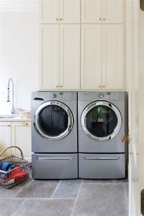 Washer And Dryer Cabinets | stacked cabinets above washer dryer design decor