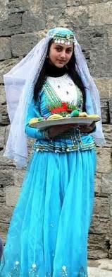 Azerbaijani girl in national costume at nowruz holiday in baku
