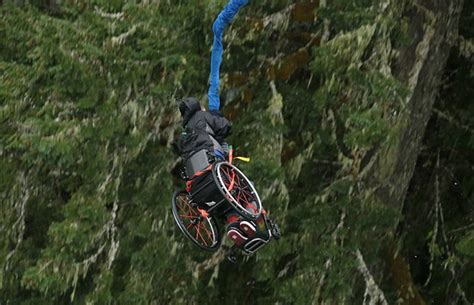 Bungee Jumping Chair - daredevil bungee jumps a cliff in his wheelchair