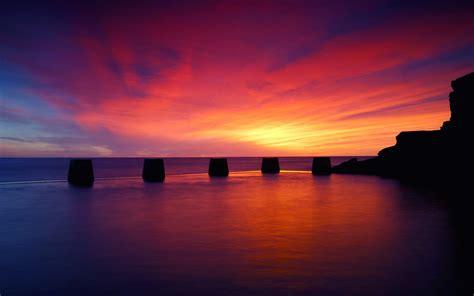 wallpaper background sunset 10 best beach sunset desktop wallpapers freecreatives