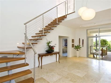 Open Stairs In Living Room by Open Plan Living Room Using White Colours With Timber