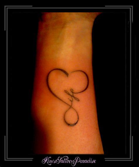 infinity tattoo zijkant pols admifind tattoo tekst onderarm