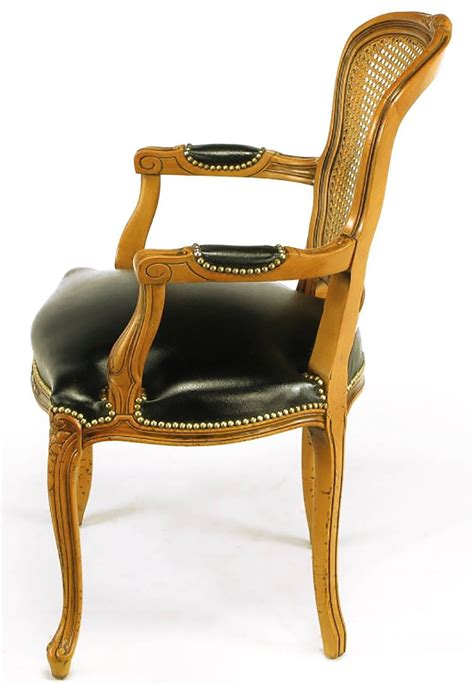 leather armchairs for sale four italian carved wood and black leather armchairs for