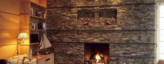 30 stone fireplace ideas for a cozy nature inspired home fireplace ideas freshome