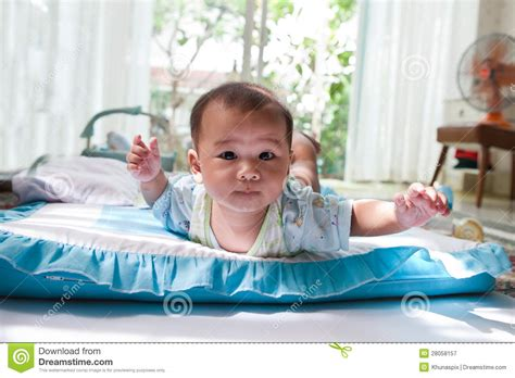 lied in bed baby lied on bed in home living room royalty free stock