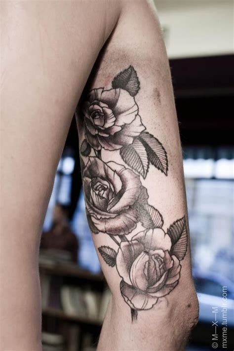 rose upper arm tattoo the location would deffs think about