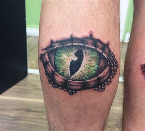 eye tattoo on knees 100 lizard tattoos for men cool reptile designs