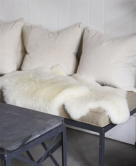 sheepskin rug on sofa make your home cozy with sheepskin rugs and throws