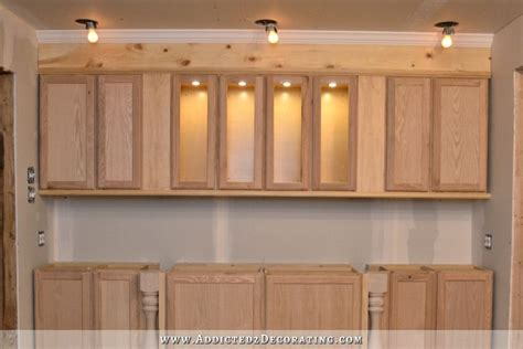 how to finish the top of kitchen cabinets the wall of cabinets build is finished in cabinet lights
