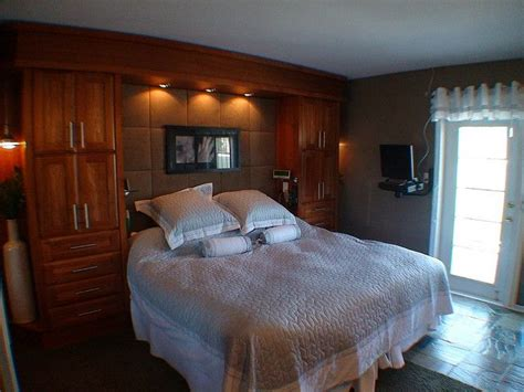 built in storage for bedrooms master bedroom built in headboard storage area use pop up swivel tv on a desk home