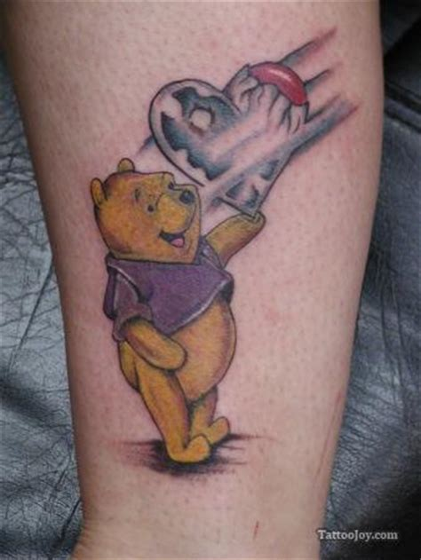 cute animal tattoo designs a that shows winnie the pooh holding