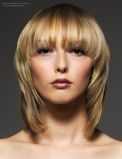 layered hairstyles with vertical roller sets vertical layered haircuts blonde medium length hairstyle