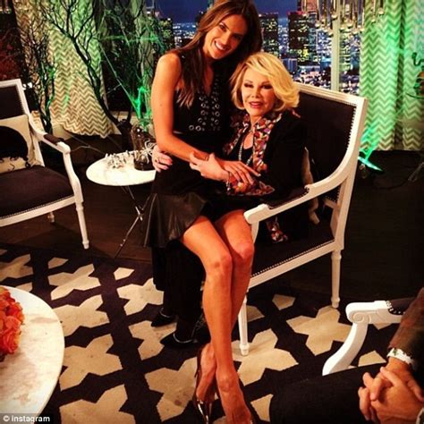 kate scow lab alessandra ambrosio sits on joan rivers lap during a