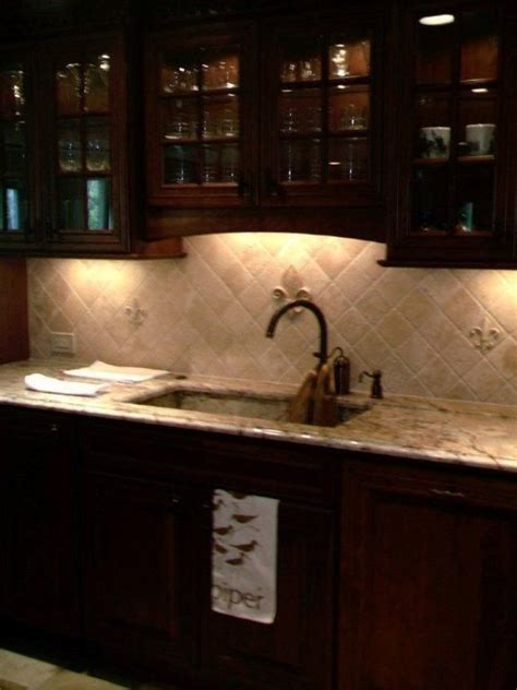 fleur de lis tile backsplash for the kitchen