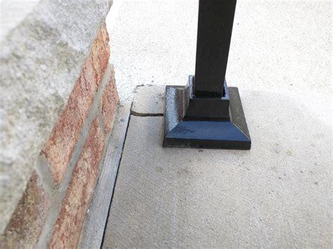 secure  loose iron railing   concrete step