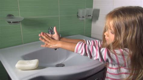 girls going bathroom close up little girl brushing her teeth before going to