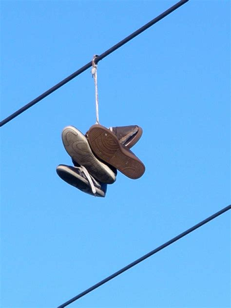 hanging photos on wire shoe tossing wikipedia