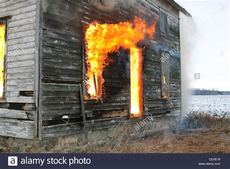 this burning house fire through windows of burning house e usa stock photo
