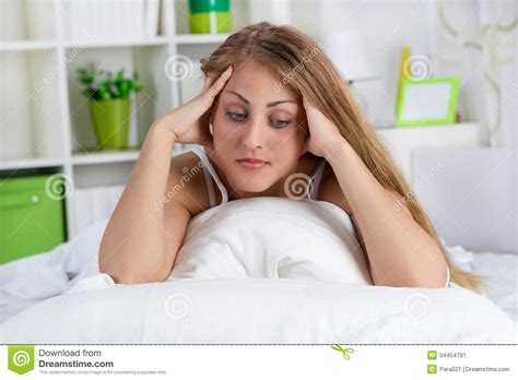 girl lying in bed lonely young woman lying in bed stock image image 34454791