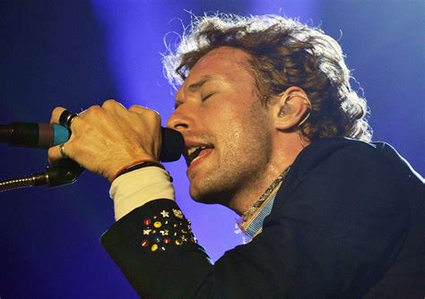 chris martin from coldplay biography listen to coldplay s broody theme for the hunger games