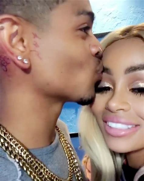 blac chyna tyga tattoo blac chyna cuddles up to rapper mechie as he smiles
