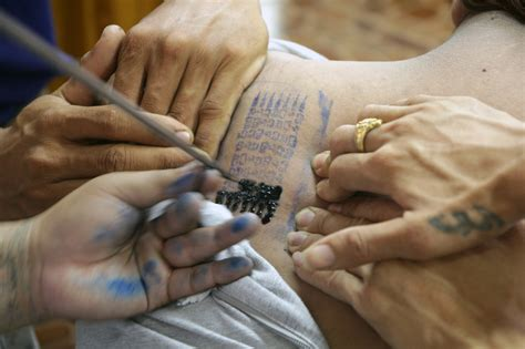 tattoo making process thousands gather in thailand to receive magical tattoos