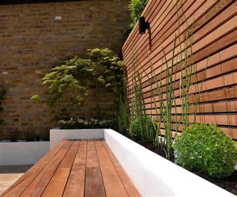 Paving Planters by Cedar Screen Raised Planter Bed Limestone Paving Hardwood