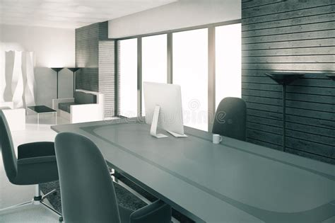 modern sunny loft office with furniture and computer stock