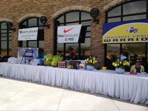 Golf Tournament Giveaways Ideas - tournament registration table set out with prizes at butterfield trail golf club