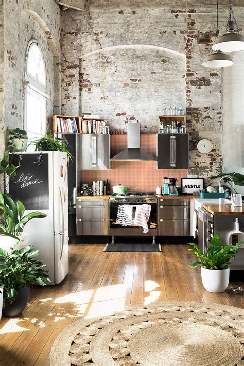 home with exposed brick and gravity home kitchen with exposed brick in a warehouse