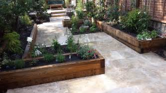 Raised Garden Patio Travertine Paving Patio Modern Garden Design Landscaping