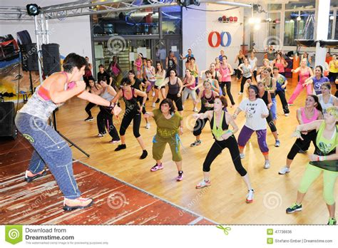 zumba workout tutorial people dancing during zumba training fitness at a gym