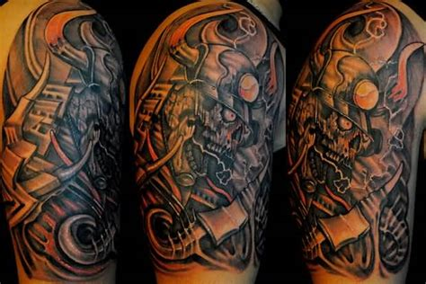 biomechanical lion tattoo dangerous biomechanical skull tattoo on upper sleeve