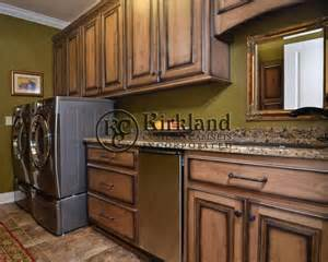 Laundry room cabinets maple wood with coffee stain and black decor