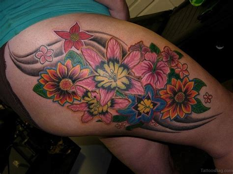 tattoo thigh evergreen flowers tattoos on thigh