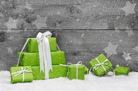 green christmas presents  snow  grey wooden background  royalty  stock images
