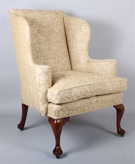 armchair legs wing arm chair on walnut cabriole legs in the classic queen anne style c 1890