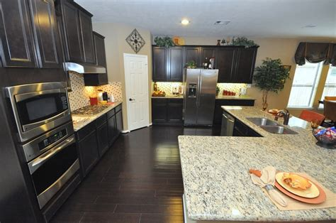 kitchen cabinets with light granite countertops dark kitchen cabinets and light granite countertop