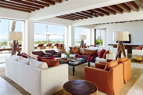 two living rooms side by side and rande gerber and george clooney s side by side mexican villas photos