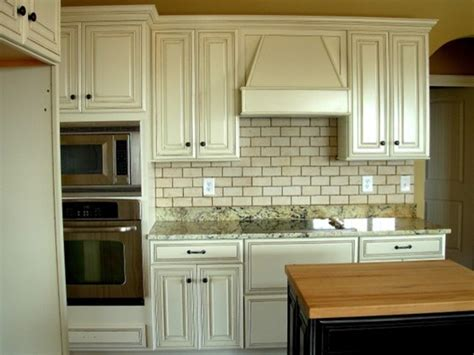 distressed painted kitchen cabinets knotty alder cabinets painted white home design by