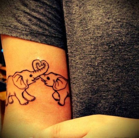 elephant couple tattoo bicep tattoos askideas