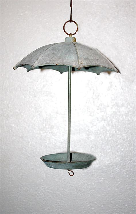vintage solid iron hanging umbrella bird by queenieseclectic