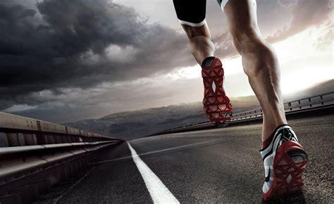 Sport Running sports background runner running on road closeup on