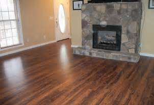 laying laminate wood flooring around fireplace
