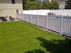 vinyl columbia yard fence installed around an inground