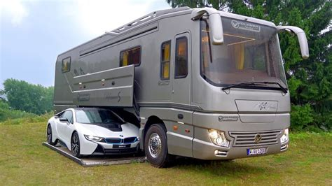 volkner mobil this 1 7 million motorhome with its own garage may look