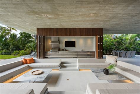 design house studio miami this tropical paradise home has an all natural swimming lagoon filled with live fish inhabitat