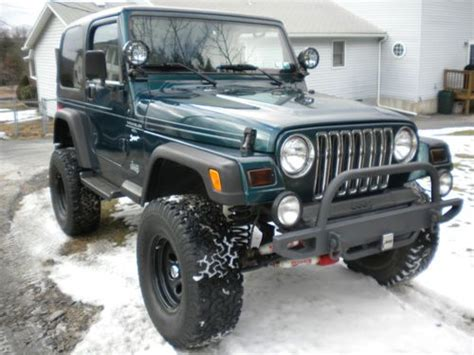 lowered 4 door jeep wrangler purchase used 1998 jeep wrangler sport 4 0l lifted 4x4