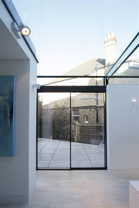 glass roof one fixed one sliding minimal window meeting a structural