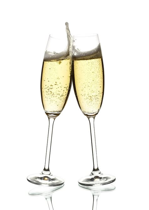 clinking glasses happy new year i m not recommending any sparkling wine
